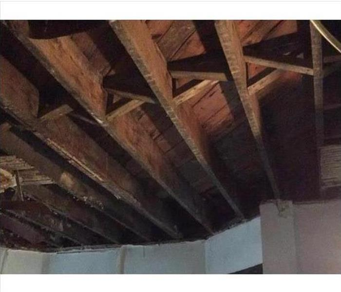 the rafters above the fire damaged ceiling after they had been cleaned