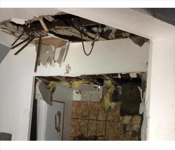 fire damaged ceiling with drywall hanging down