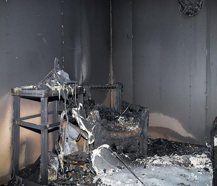 room covered in soot after a fire