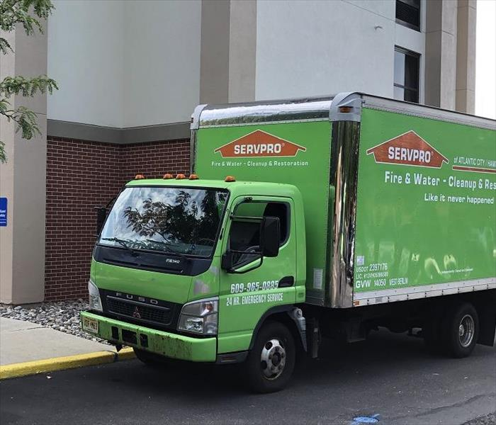 SERVPRO truck in front of building