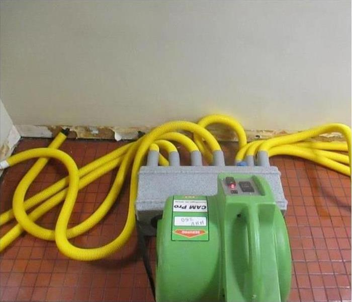 Our drying equipment set out drying the floor after water damage struck this property